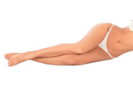 feet naked: Woman laying on the white floor. Copyspace.