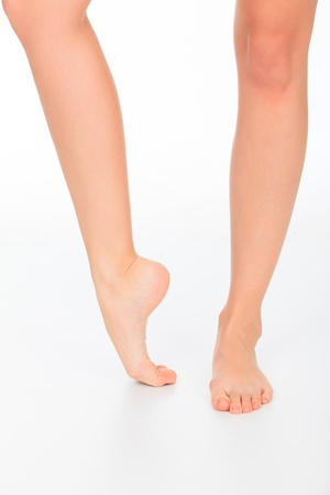 Woman legs on white photo
