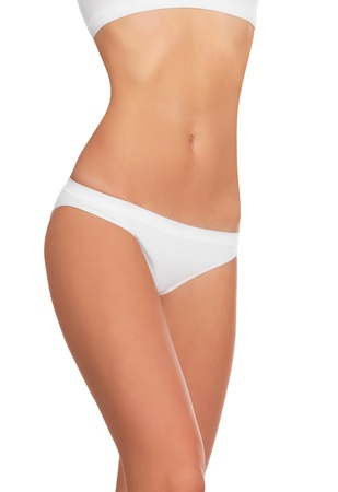Slim woman body on white background photo
