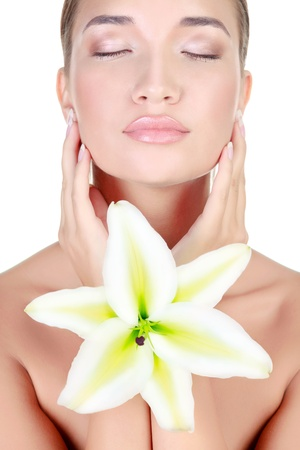 pampered: Beautiful face of young asian woman with big lily  Beauty treatment concept Stock Photo