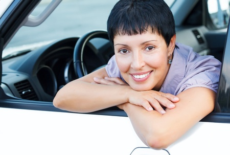 woman driving car: Smiling senior woman in a car