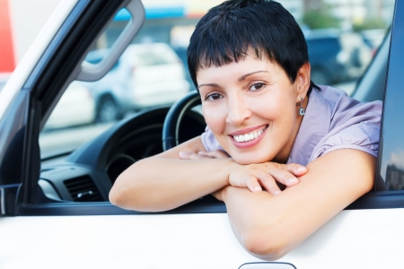 Smiling senior woman in a car  photo