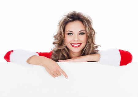 Woman in red dress holding a blank billboard, white background, copyspace