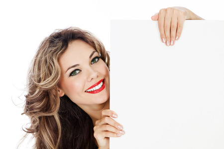Young smiling woman shows blank card. photo