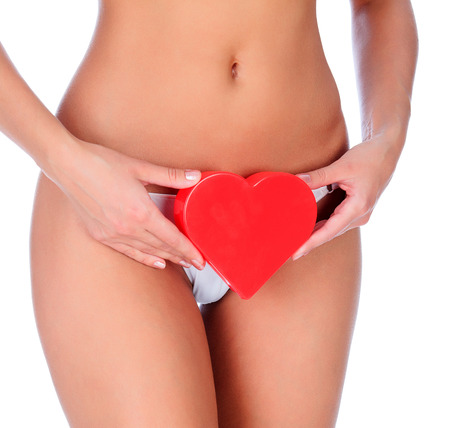 Woman with a red heart, white background photo