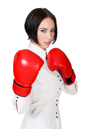Businesswoman with red boxer gloves, white background, copyspace  photo