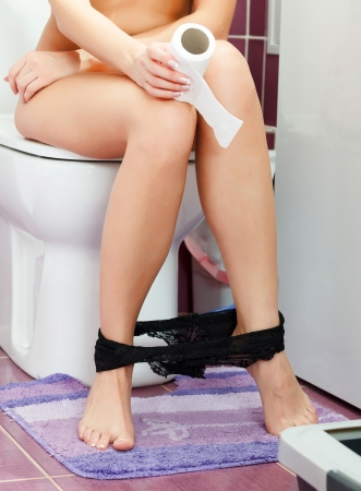constipated: Woman in the toilet