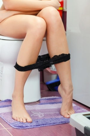 peeing: Woman in the toilet