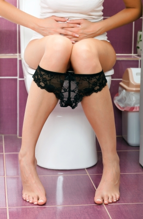 hemorrhoids: Woman in the toilet  Stock Photo