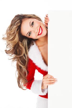 santa's helper: Woman in red dress with an empty billboard Stock Photo
