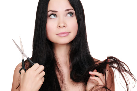 Woman with scissors, white background, copyspace