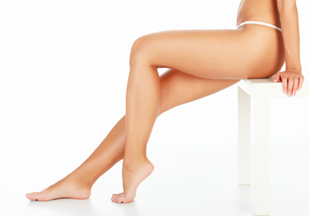 Female legs on white background, copyspace photo