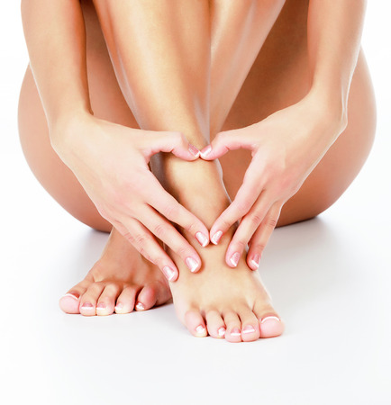 Woman loves her legs, white background photo