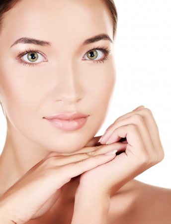 body care: Beautiful girl with clean fresh skin, white background, copyspace Stock Photo
