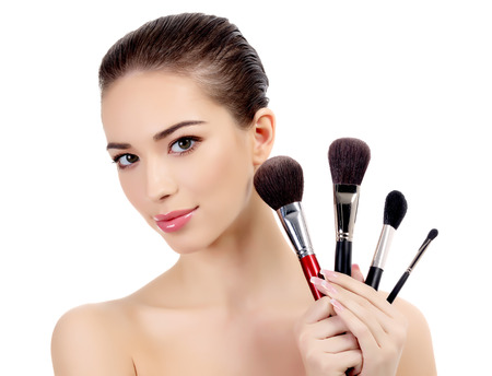 make up brush: Pretty woman with cosmetic brushes, white background, copyspace