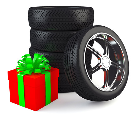 Car wheels with big red gift box, white background, copyspace photo