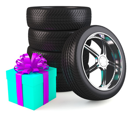 Car wheels with big gift box, white background, copyspace photo