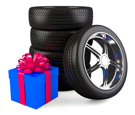 Car wheels with big gift box photo