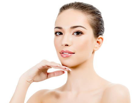 Beautiful girl with clean fresh skin, white background, copyspace Stock Photo