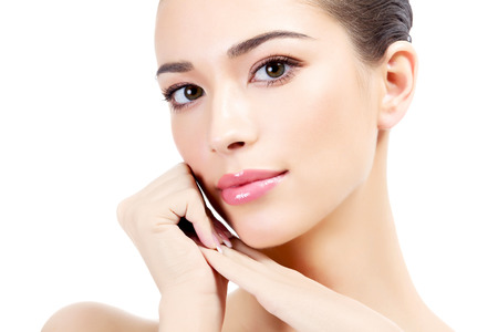 health and beauty: Beautiful girl with clean fresh skin, white background  Stock Photo