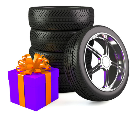 Car wheels with big gift box, white background  photo