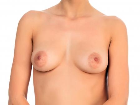 naked female: Naked female breast, white background, copyspace