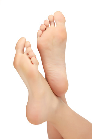 footcare: Healthy female feet, white background, copyspace