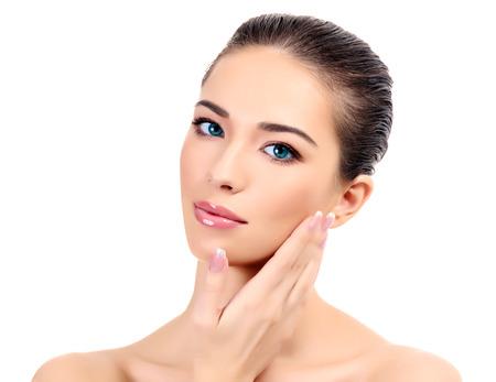 Beautiful girl with clean fresh skin, white background