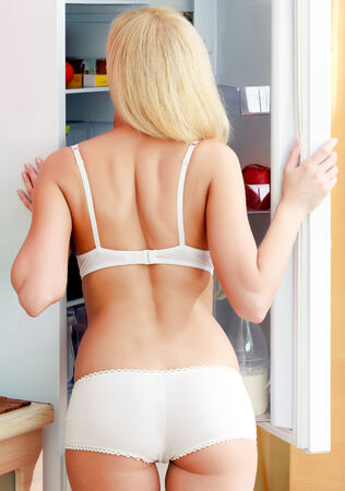 woman looking something at fridge photo