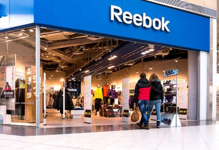 EKATERINBURG, RUSSIA - NOV 24: Shoppers visit Reebok Center in Mega Mall on Nov 24, 2013 in Ekaterinburg, Russia. Mega Mall is one of the biggest malls in Russia and is currently home to over 1000 retail outlets and services