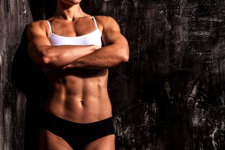 muscled: Muscled woman against the scratched grunge background