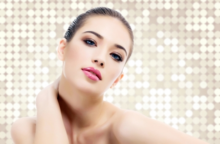 makeup face: Pretty woman against an abstract background with circles and copyspace