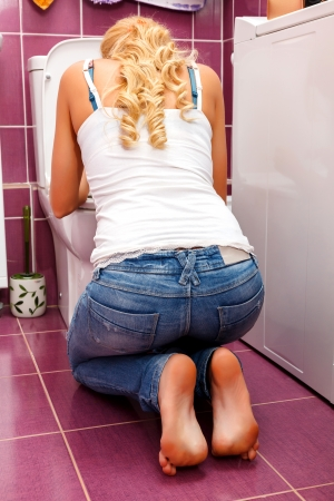 bulimia: Hangover after a party, woman in the toilet