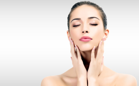 makeup face: Pretty woman against grey