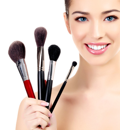 Female with cosmetic brushes