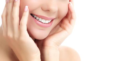 Cheerful female with fresh clear skin, white background photo