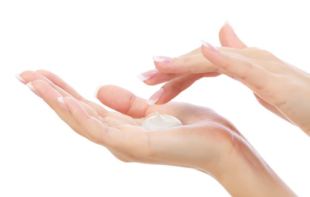 cream: Female hands on white Stock Photo