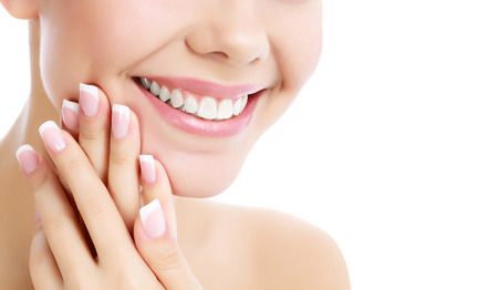 Face, hands and healthy white teeth of a woman, white background