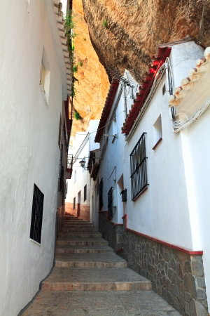 view of street between the rocks in Setenil de las Bodegas, Cadiz ,Spain  photo