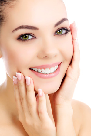 Cheerful female with fresh clear skin, white background
