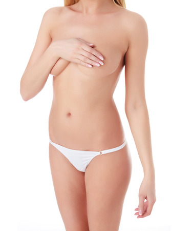 Body of beautiful woman covering her breast with hand, white background photo