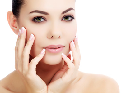 skin treatment: Young female with fresh clear skin, white background