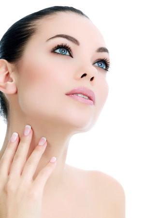 beauty surgery: Young female with fresh clear skin, white background