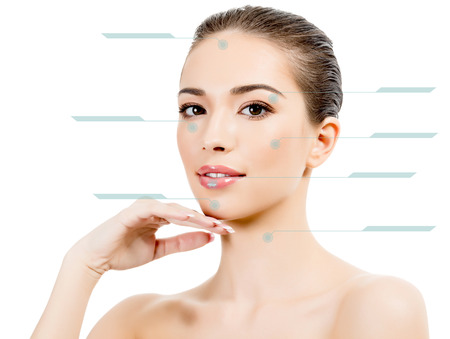 Young female with clean fresh skin, white background