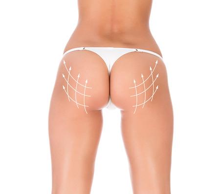 fesse: beau corps f�minin avec les fl�ches, fond blanc