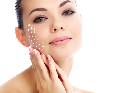 botox: Young female with clean fresh skin, white background