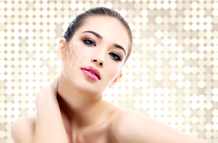 Young female with clean fresh skin, abstract background photo