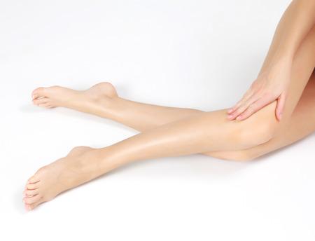 Female legs on white floor photo