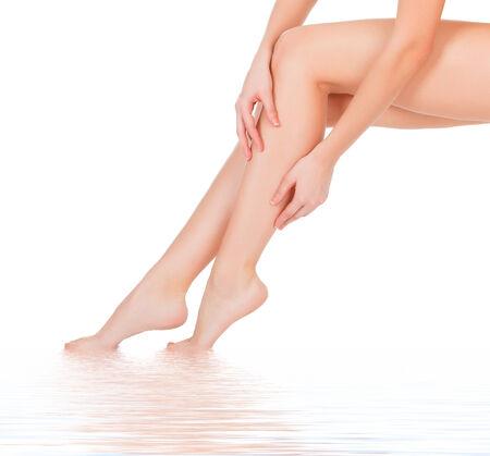 Smooth skin on female legs. White background  photo