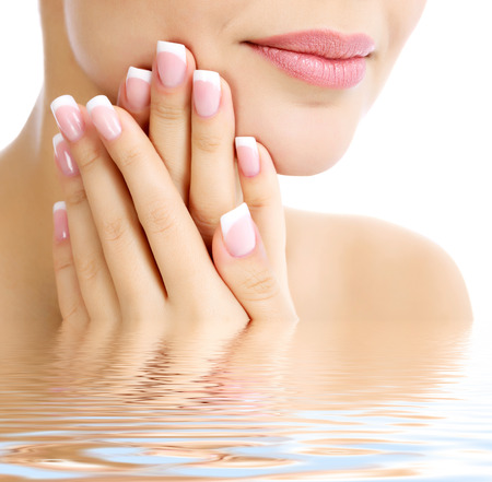 Part of female face and hands, white , copyspace Stock Photo